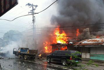 Rare car bomb kills 8, ignites fires in Cotabato City