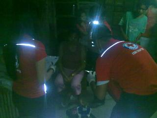 Red Cross personnel attend to survivors of ships collision