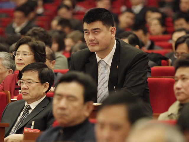 What Size Shoe Does Yao Ming Wear Houston yao ming wears a