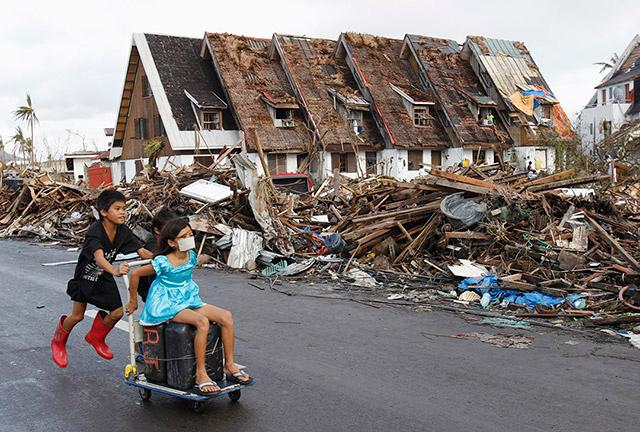 Tacloban Residents Try To Cope With Yolanda Aftermath on After Typhoon Haiyan Devastated Central Philippines On November 8