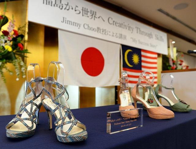 8e2f880a3c0 Three pairs of one-off shoes by Malaysian designer Jimmy Choo are displayed  in Fukushima
