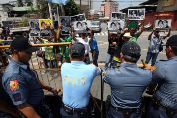 Militants rally near Aquino residence
