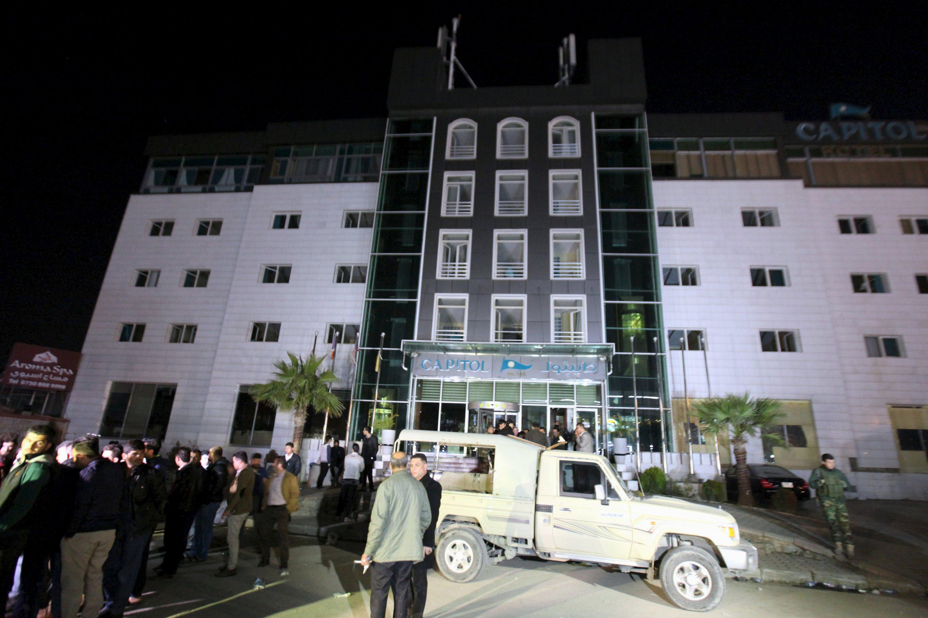 Police and military personnel cordon off the Capitol Hotel in Erbil. REUTERS