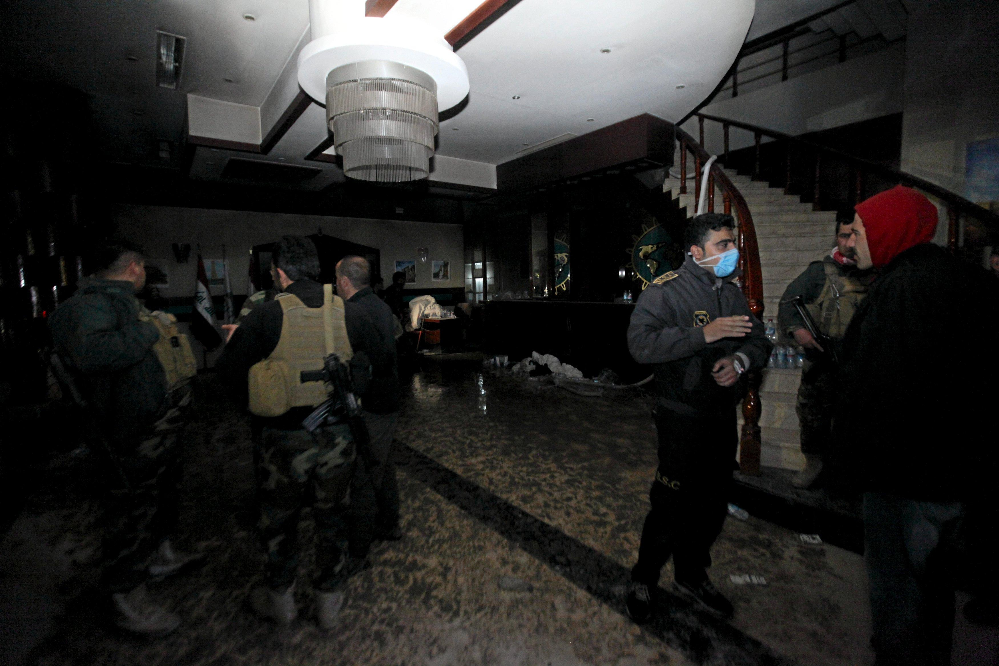 Iraqi authorities at the lobby of the Capitol Hotel in Irbil. REUTERS