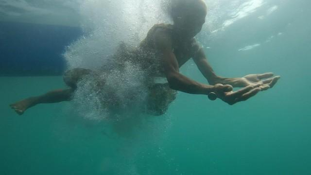 VIDEO: 74-year-old grandma dives into the ocean to get coins