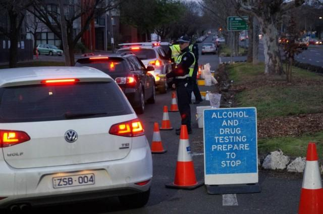 Random breath testing to detect alcohol is a highly visible exercise. Such tests could be encountered anywhere and at any time in the land Down Under. Photo: WHO/Passmore