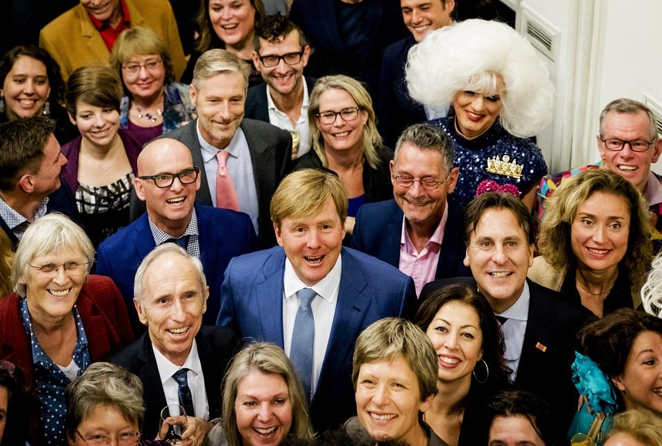 Dutch King Willem-Alexander (C) poses during a visit to COC Netherlands, an  interest group for LGBT men and women, during a celebration for its 70th ...