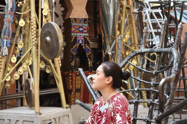 Lilianna Manahan surrounded by the minarets she designed. Photo: Aya Tantiangco.