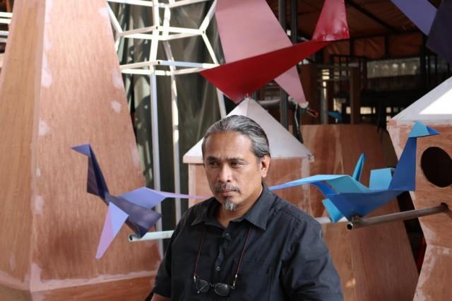 Toym Imao among the steel origami cranes. Photo: Aya Tantiangco.