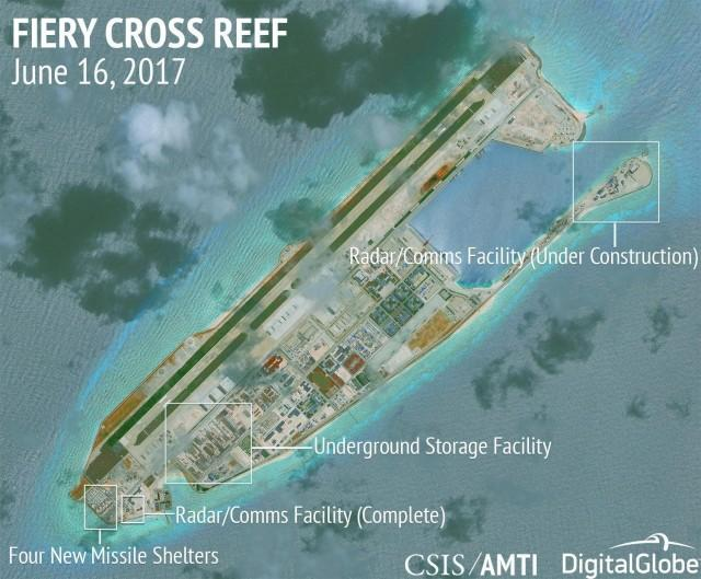 Construction is shown on Fiery Cross Reef, in the Spratly Islands, the disputed South China Sea in this June 16, 2017 satellite image released by CSIS Asia Maritime Transparency Initiative at the Center for Strategic and International Studies (CSIS) to Reuters on June 29, 2017. MANDATORY CREDIT CSIS/AMTI DigitalGlobe/Handout via REUTERS/File Photo