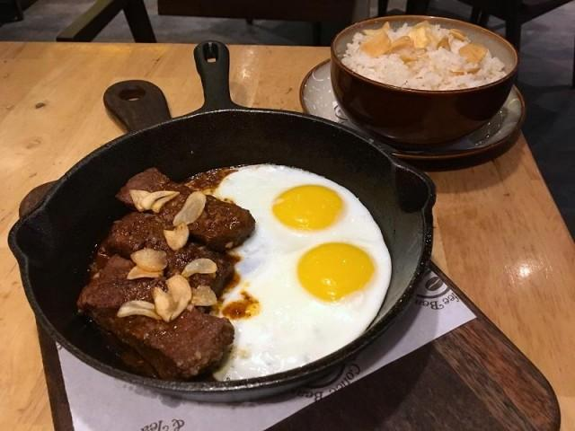 With its preium USD beef, its steak and eggs is leveled-up tapsilog. Photo: Nikka Sarthou-Lainez