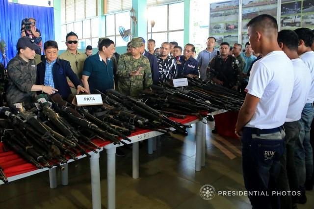 President Rodrigo Duterte leads the inspection of the firearms handed over by surrenders from the stronghold of pro-Islamic State militants group Abu Sayyaf at the Capitol Site in Patikul, Jolo, Philippines March 26, 2018. Presidential Palace/Handout via Reuters