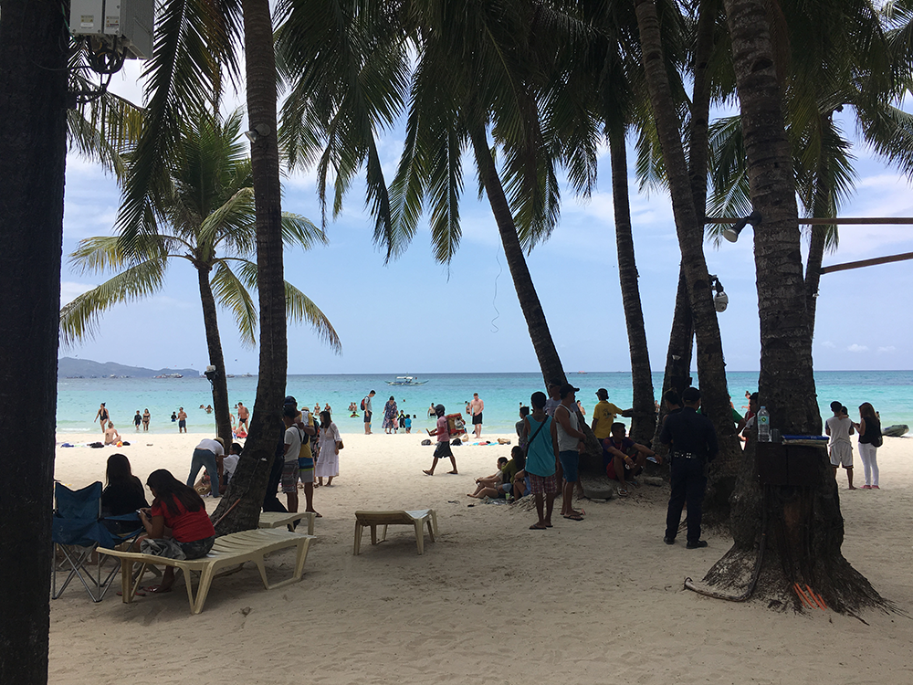 Policemen patrol parts of Boracay on Holy Week, when around 58,000 tourists are expected to flock to the island. Jam Sisante-Cayco
