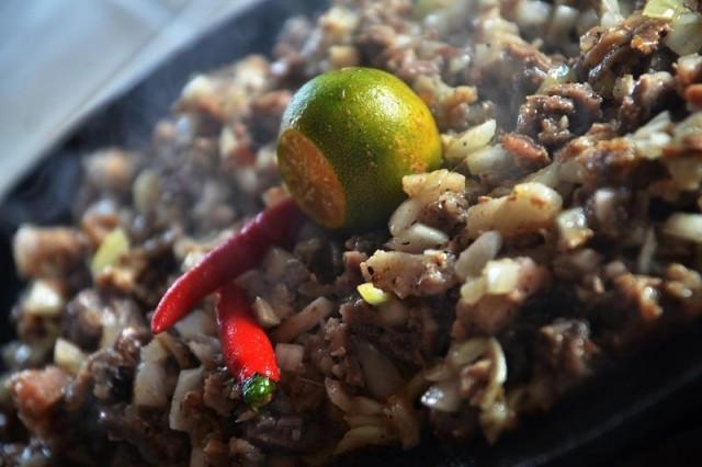 Crunchy, served in a sizzling plate to accompany beer: This is how we know and love sisig