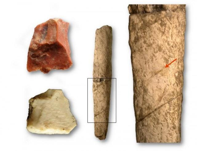 This handout image obtained from the French Museum of Natural History (MNHN) on May 2, 2018 shows Two cut flakes and a rib of rhinoceros at the Kalinga site, all evidence of the presence of a hominkin 709 000 years ago retrieved from the site of an archaeological dig at Kalinga in the Philippines. Thomas INGICCO / MNHN / AFP