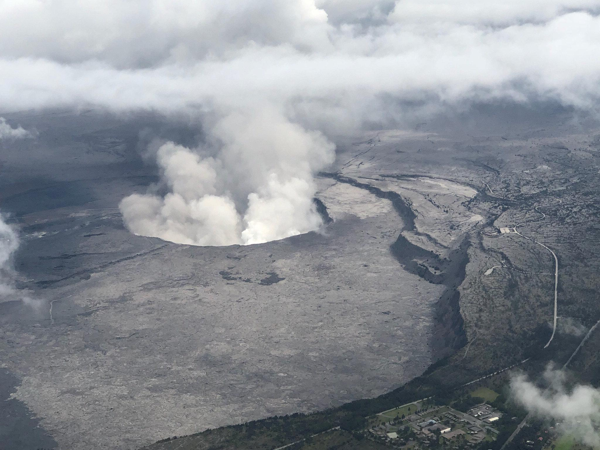 Image result for Explosion at Hawaii volcano spews ash as lava flows into sea
