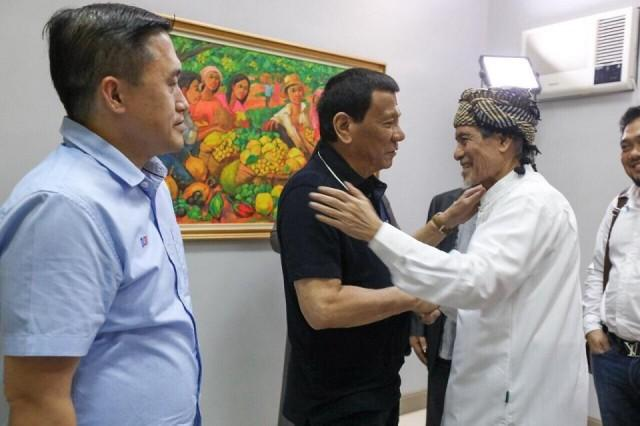 President Rodrigo Duterte and Nur Misuari greet each other in Davao City on August 22, 2018. Last month, after enacting the Bangsamoro Organic Law, Duterte invited the Moro National Liberation Front founding chairman to talk. Photo: Malacañang