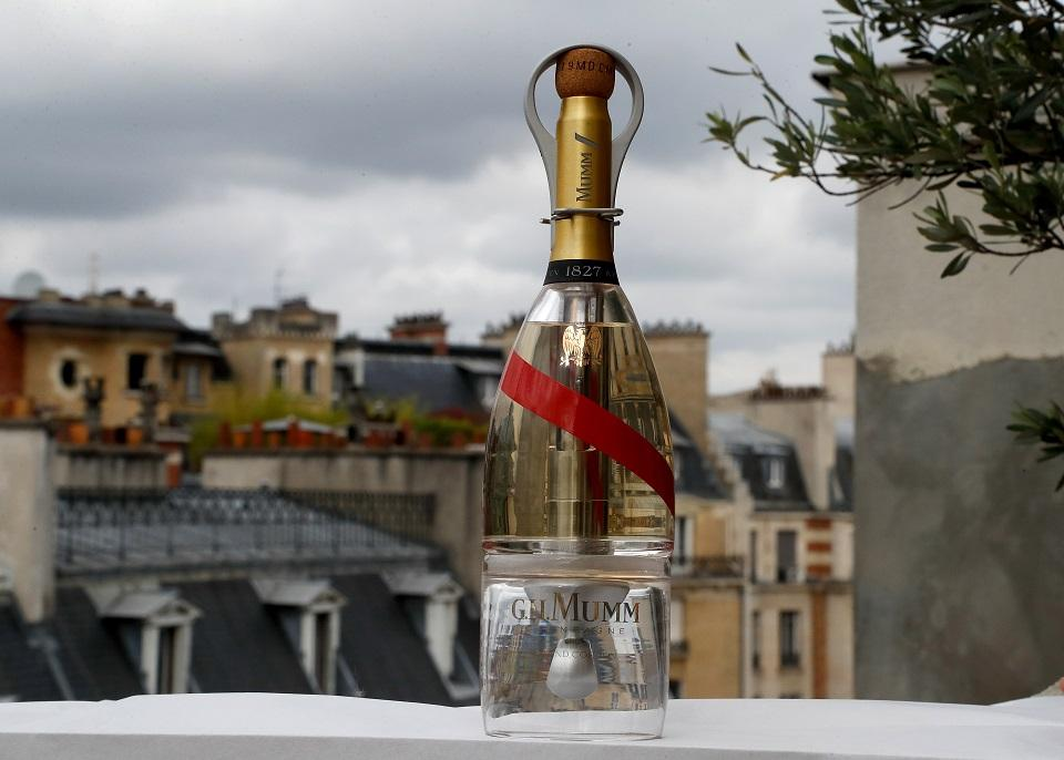 A picture taken on September 6, 2018 in Paris shows a bottle of Mumm Grand Cordon Stellar champagne, designed by French Interior designer Octave de Gaulle, that will be drunk by space tourists using a container bottle adapted to pour the bubbly liquid in zero gravity conditions. Francois Guillot/AFP