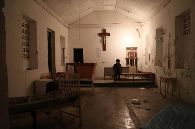 A woman sits inside the chapel of the hospital after an earthquake hit northern Haiti late on Saturday, in Port-de-Paix, Haiti, October 7, 2018. REUTERS/Ricardo Rojas