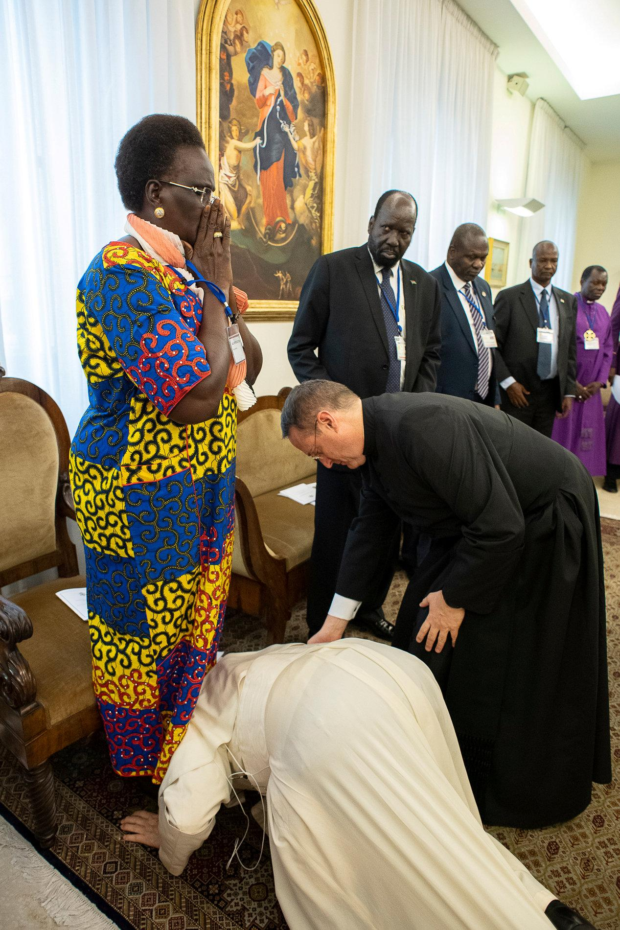 Image result for pope francis kisses feet
