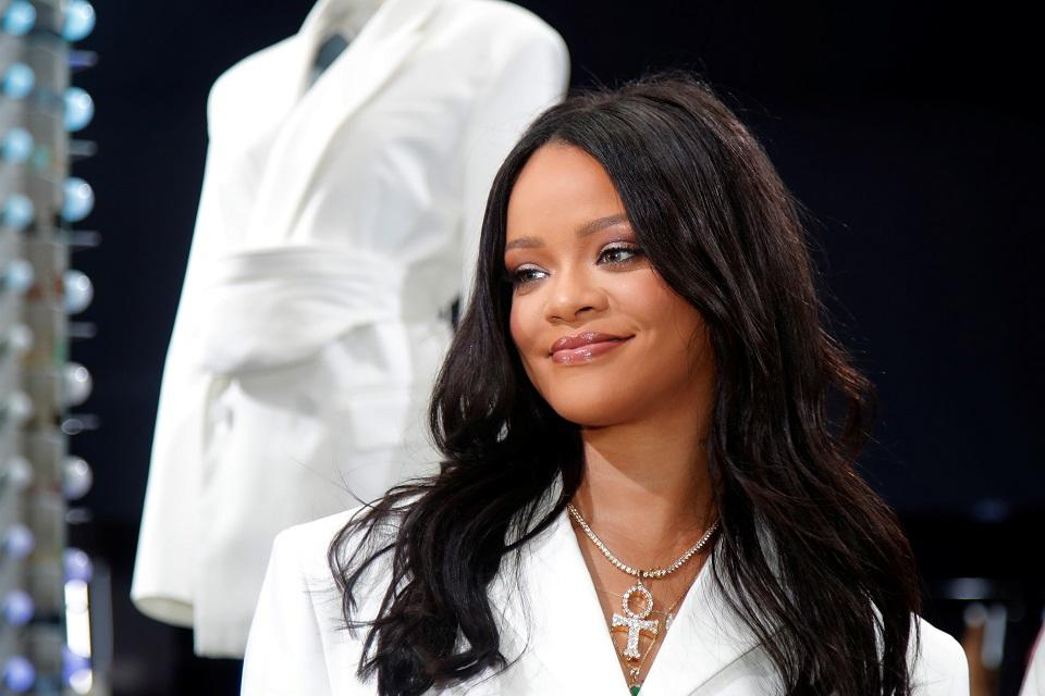 Pop superstar Rihanna poses in a pop-up store to present her first collection with LVMH for the new label, Fenty, which includes ready-to-wear and accessories, such as shoes, sunglasses and jewelry, Paris, France May 22, 2019. REUTERS/Charles Platiau