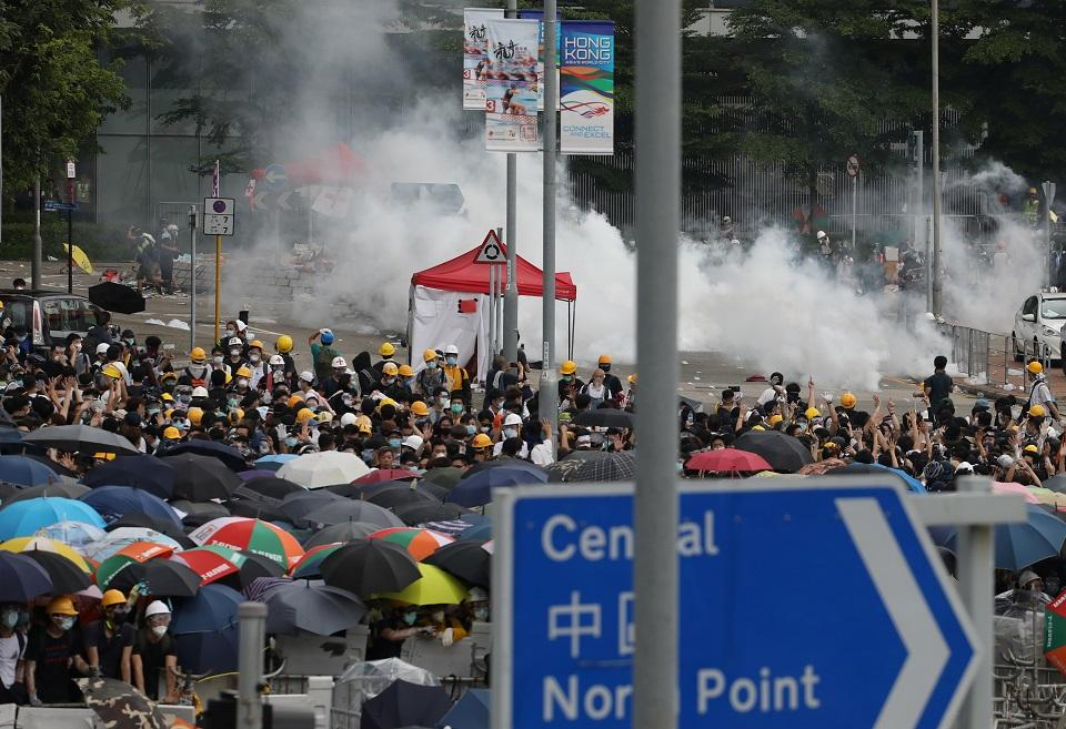 Hong Kong police fire first gunshot, water cannon in protest