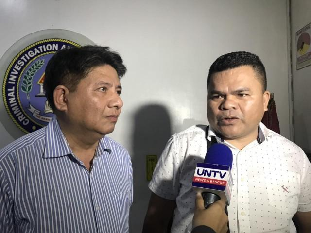 Lawyer Larry Gadon (left) and Perfecto Tagalog talk to reporters at the CIDG on August 27, 2019. Anna Felicia Bajo