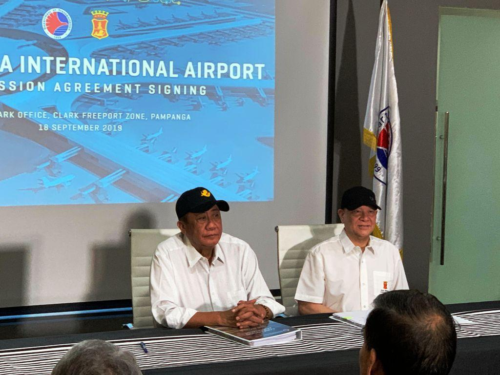 Transportation Secretary Arthur Tugade (left) and San Miguel Corp. president and COO Ramon Ang officially signed the concession deal for the New Manila International Airport on Wednesday, Sept. 18, 2019 In Clark, Pampanga. Ted Cordero