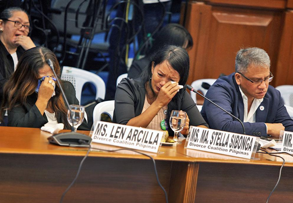 Ma. Stella Sibonga and Len Arcilla of the Divorce Coalition of the Philippines become emotional as they testify at a Senate inquiry into the divorce bill on Tuesday, September 17, 2019. Benjie Castro