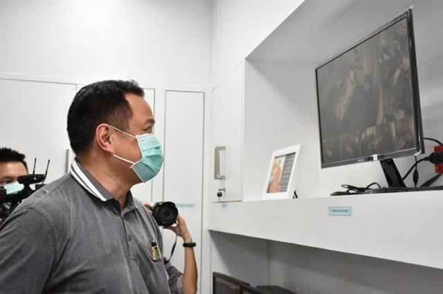 This handout photo from Thailand's Public Health Ministry taken and released on February 2, 2020 shows Health Minister Anutin Charnvirakul viewing closed circuit video images in Bamrasnaradura Infectious Disease Institute in Nonthaburi outside Bangkok where patients infected with SARS-like virus are confined. Handout/Thailand Public Health Ministry/AFP