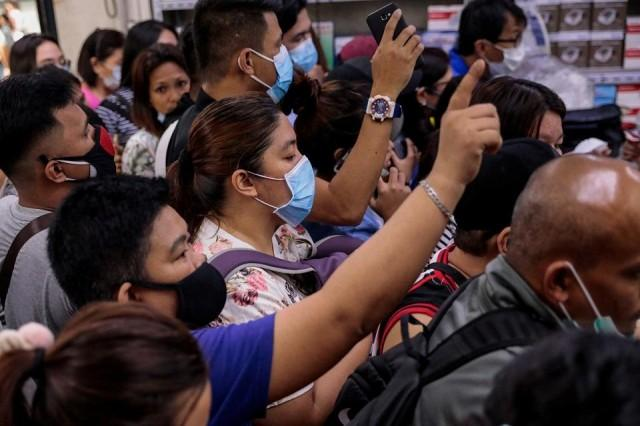 People scramble to buy face masks in a medical supply store a day after the Philippine government confirmed the first novel coronavirus case, in Manila, January 31, 2020. REUTERS/Eloisa Lopez