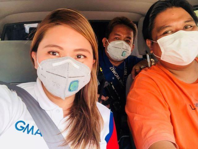 TV Journalist Bernadette Reyes and her crew wear their masks on the way to their assignment.