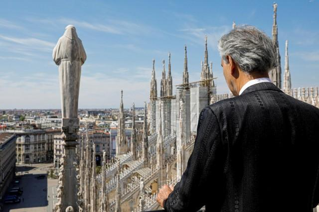 Italian opera singer Andrea Bocelli prepares for the ''Music for hope'' event, a streamed live performance intended as a symbol of love, hope and healing amidst the coronavirus disease (COVID-19) outbreak, on Easter Sunday, near the Duomo Cathedral in Milan, Italy, April 12, 2020. Luca Rossetti/Courtesy Sugar Srl/Decca Records/Handout via REUTERS