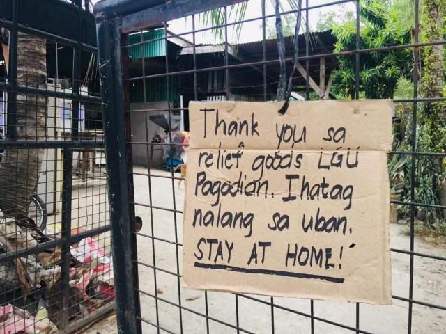 Pagadian City residents set up signs on doors/gates saying they refuse to accept relief goods and instructs the local government to hand them out to those who need them most. PHOTO FROM Asenso Pagadian
