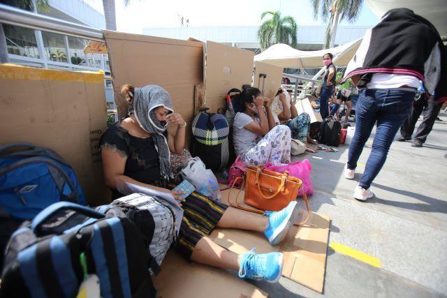 Overseas Filipino workers stranded at the Ninoy Aquino International Airport. Photo: DANNY PATA