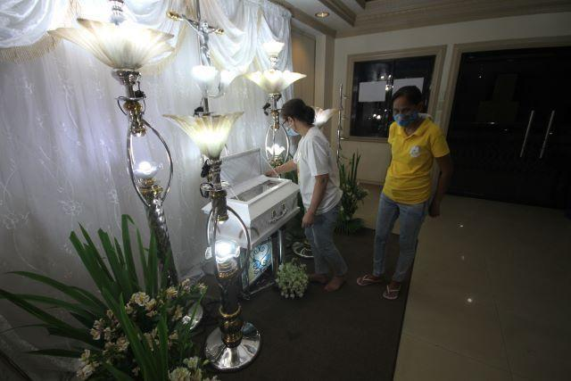 Marites Asis (in yellow)grandmother of Baby River Emmanuel Nasino, and her sister Veronica Vidal pay their last respects to the remains of Baby River, the 3 month old daughter of detained activist and urban poor advocate Reina Mae Nasino, who is a detainee at the Manila City Jail. DANNY PATA