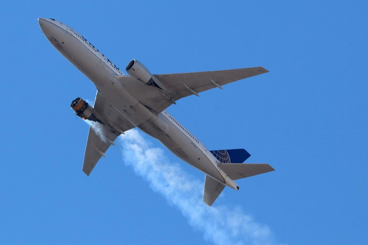 United Airlines flight UA328, carrying 231 passengers and 10 crew on board, returns to Denver International Airport with its starboard engine on fire after it called a Mayday alert, over Denver, Colorado, US February 20, 2021. Hayden Smith/@speedbird5280/Handout via REUTERS