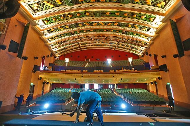 Workers put finishing touches to the Metropolitan Theater on Tuesday, June 22, 2021, in Lawton, Manila, for its soft opening on June 23, 2021. DANNY PATA