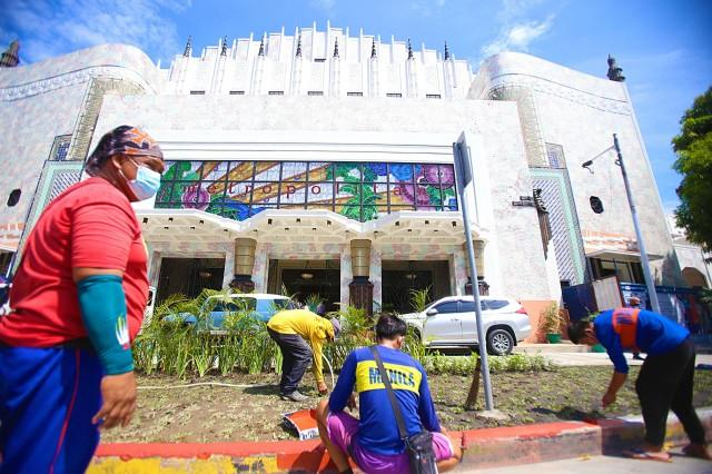 Workers put finishing touches to the Metropolitan Theater on Tuesday, June 22, 2021, in Ermita, Manila, for its soft opening on June 23, 2021. DANNY PATA