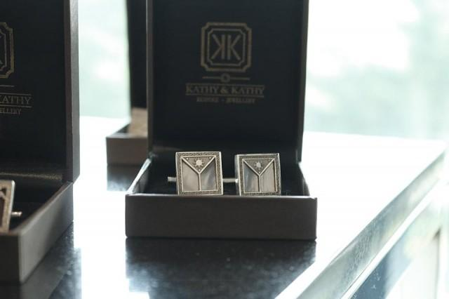 Silver and mother of pearl cufflinks designed by Kathy & Kathy. Photo: Aya Tantiangco / GMA News.