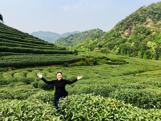 "Martinez at the Hangzhou-Longjing Tea Farm. ""As a tea sommelier, we also study terroir [how environment affects the taste of produce] and why a specific tea tastes the way it does…I personally go direct to tea farms during the spring and autumn harvests to learn from the tea masters and see how they live their lives."""
