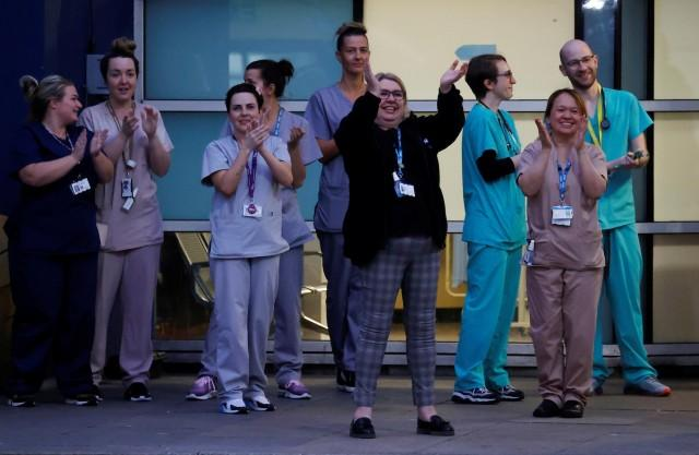 NHS workers applaud outside Royal Liverpool University Hospital during the Clap for our Carers campaign in support of the NHS as the spread of the coronavirus disease (COVID-19) continues, Liverpool, Britain, April 2, 2020. REUTERS/Phil Noble