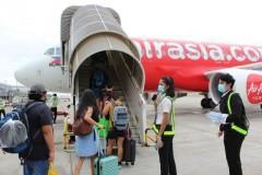 Repatriated OFWs from Myanmar board plane for PHL