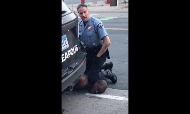 """This still image taken from a May 25, 2020, video courtesy of Darnella Frazier via Facebook, shows a Minneapolis, Minnesota, police officer arresting George Floyd. """"The four Minneapolis police officers involved in Floyd's death have been fired,"""" Minneapolis Mayor, Jacob Frey, said on Twitter on May 26, saying """"it was the right decision. Witnesses say Floyd repeatedly tell the officers, """"I cannot breathe!"""" after being pinned to the ground by an officer with his knee on Floyd's neck. Darnella Frazier / Facebook/Darnella Frazier / AFP"""