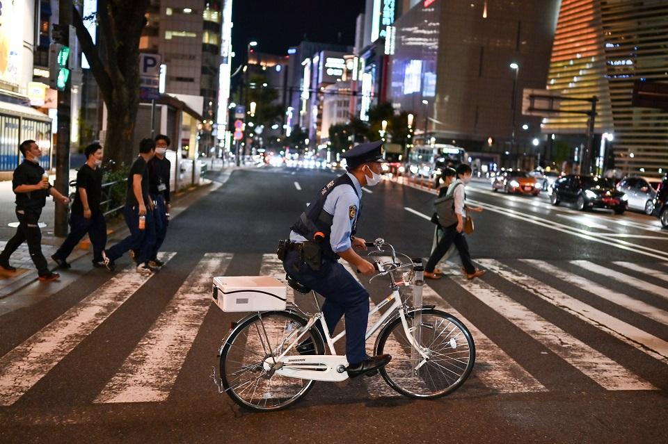 Japan to ease virus border restrictions next month to allow entry of more foreigners